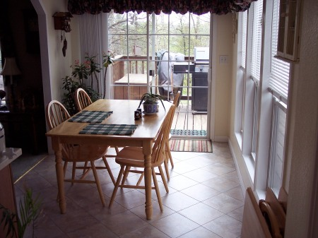 A breakfast room with new paint, new floor, and baseboards