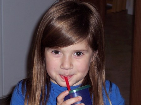 Emma drinking her juice