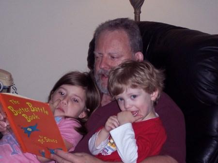 Emma & Dominic help Grandpa read a book