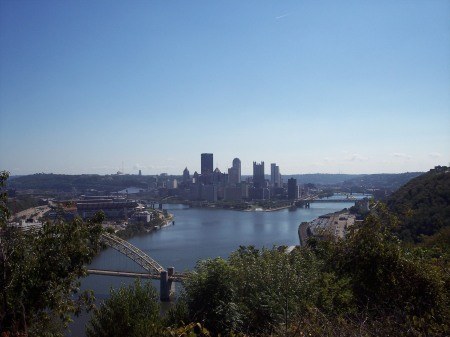 Pittsburgh surrounded by hills and trees